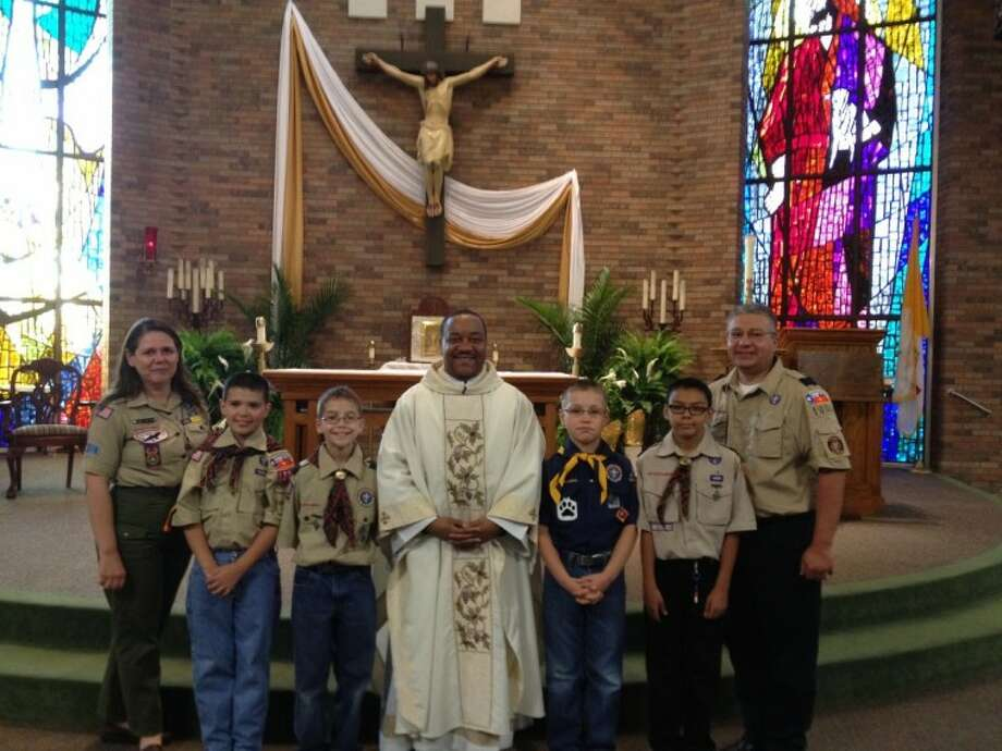 Pictured from left to right- Leslie Melton-Religious Emblems Coordinator, Trent Butler, Anthony Palacios, Father Reginald Samuels, Nicholas Talevich, Jeremy Casanova and Tom Butler-Director of Religious Education at St. Hyacinth Catholic Church