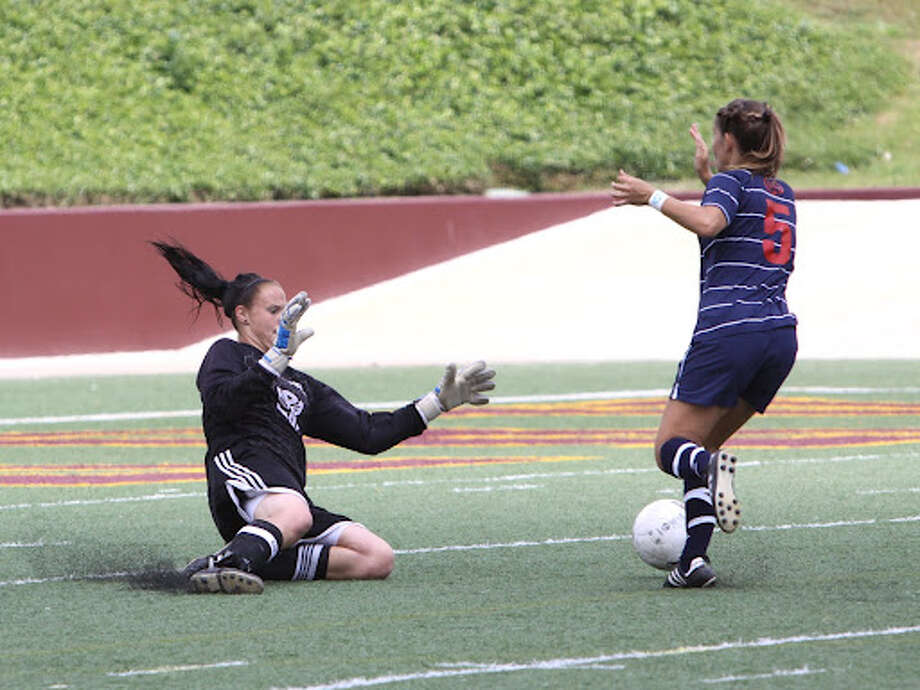 Seven Lakes goalkeeper Kylie Hambleton blocks a shot from Clear Lake's Jill Lutz during the two teams' shootout in the UIL Region III-5A girls' soccer final on Saturday in Deer Park.  Photo: George Racine