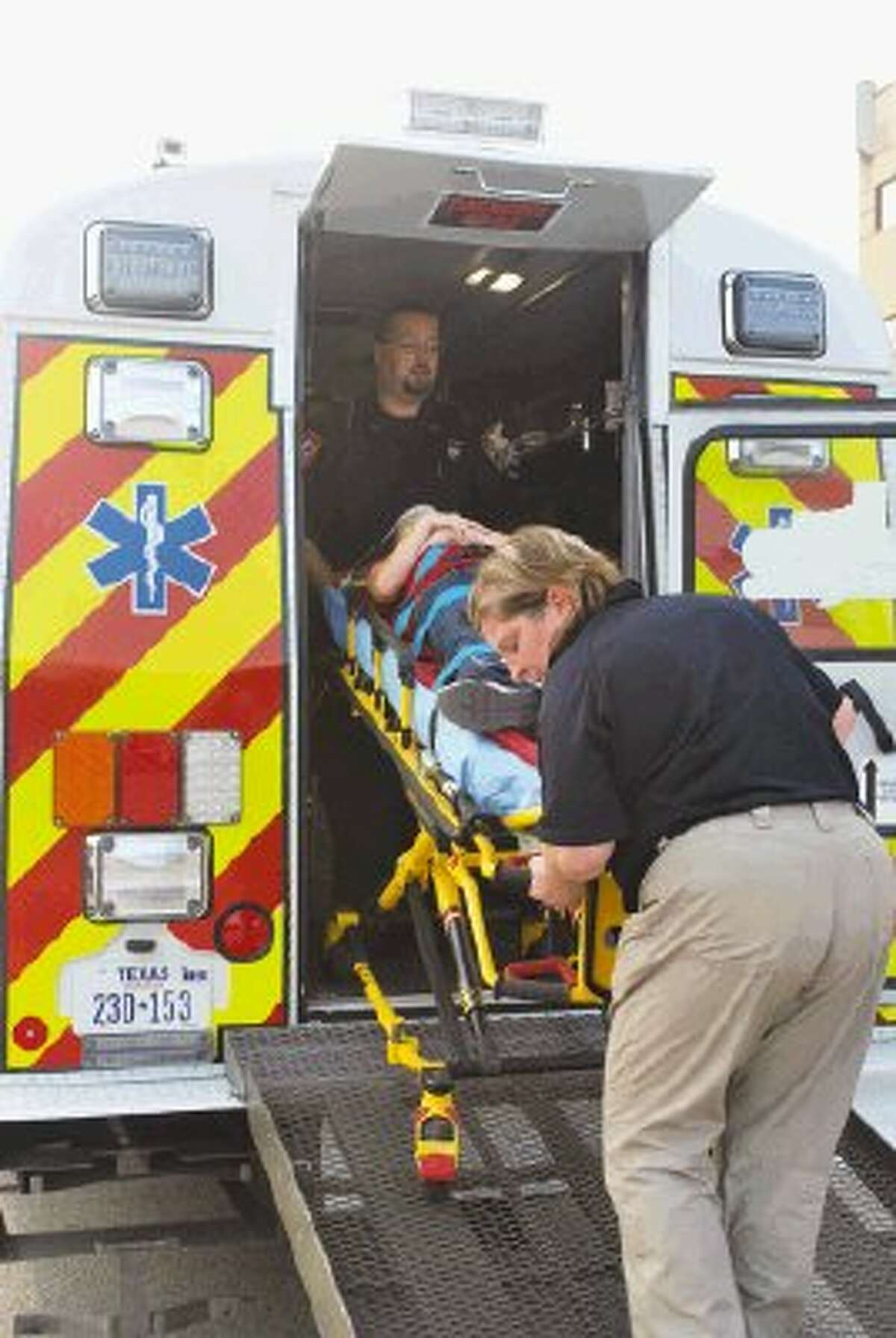 A young patient is loaded into the AVFD AmBus after a Huffman ISD school bus accident Thursday.