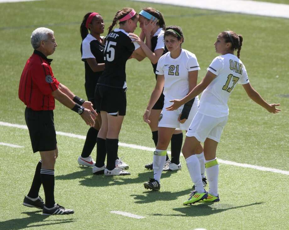 Klein Oak defender Kristen Champion (17) argues a call with a referee during the girls soccer 5A semifinals match against Plano West at Birkelbach Field on April 19, in Georgetown. Photo: Jason Fochtman