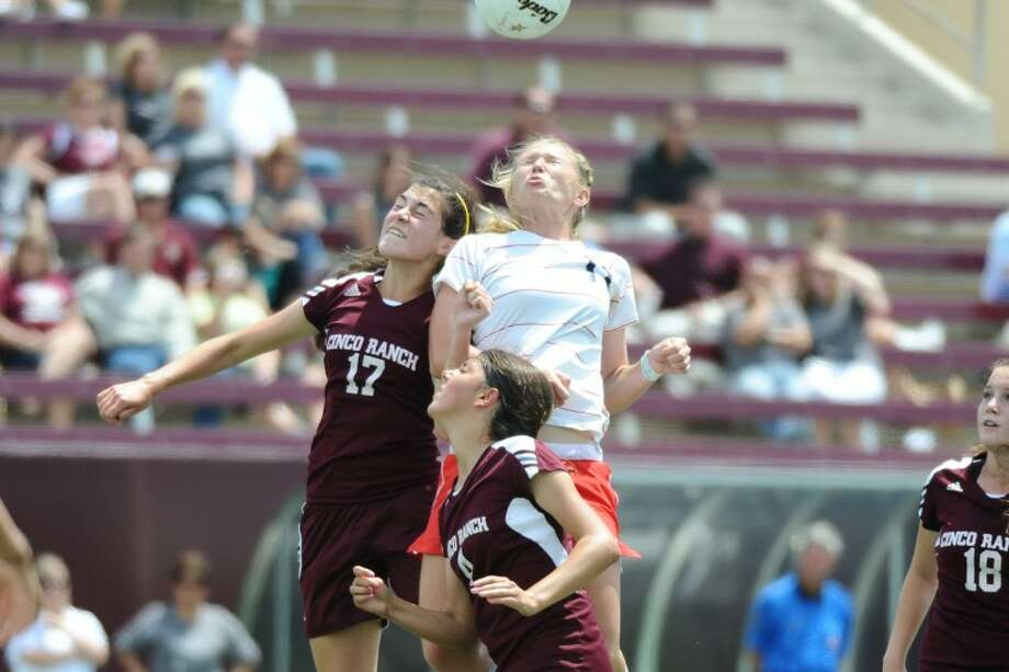 Cino Ranch's Lauren Smith (17), Maddie Nichols (4), and Clear Lake's Brooke Jennings (11) fight for the head shot in the 2012 Region III playoff game Friday, 4/13. Photo: KIRK SIDES