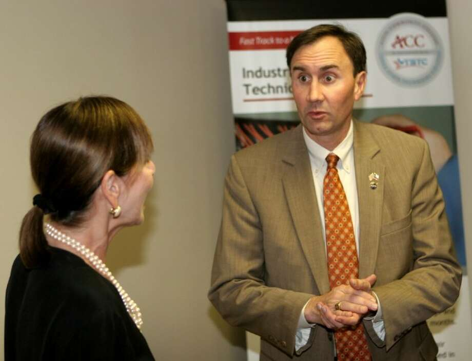 U.S. Rep. Pete Olson, right, speaks with ACC Dean of Continuing Education, Dr. Patricia Hertenberger during a tour of ACC's Pearland Center on April 23. Photo: ACC