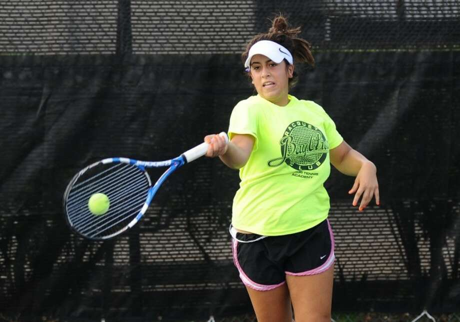 Joann Karam of Friendswood blasts a forehand while playing at the Bay Area Racquet Club on Monday. Karam is the only super championship tennis player in her age group from Galveston County. Photo: KIRK SIDES