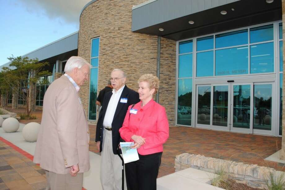 Evelyn Meador Library board member Jim Hargrove, left, thanks Lynn Meador Hall and her husband, Dan Edmundson, for attending the preview reception Friday night at the new library, which is named for her mother.