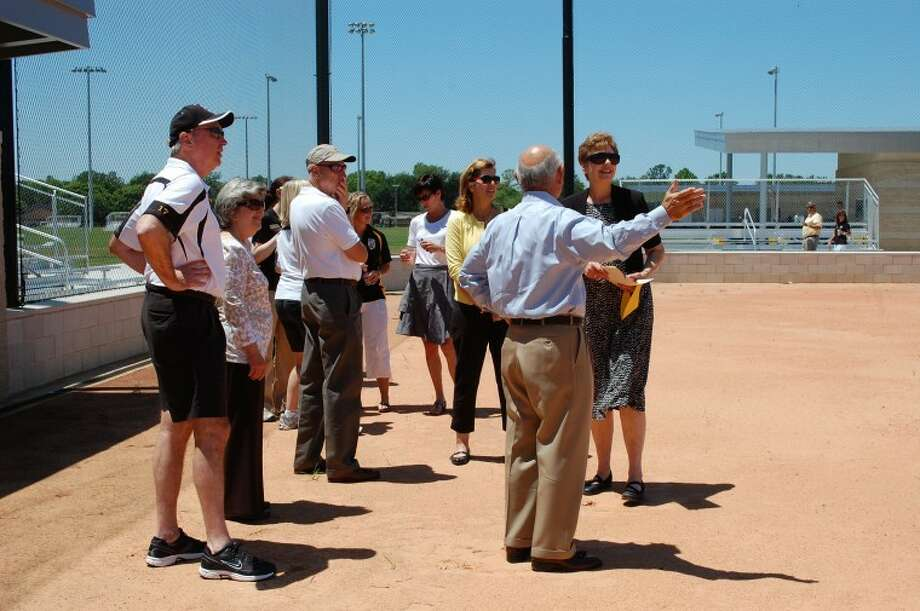 St. Agnes Academy Head of School Sr. Jane Meyer gives a tour of the new softball field to a group of supporters Sunday. Photo: St. Agnes Academy
