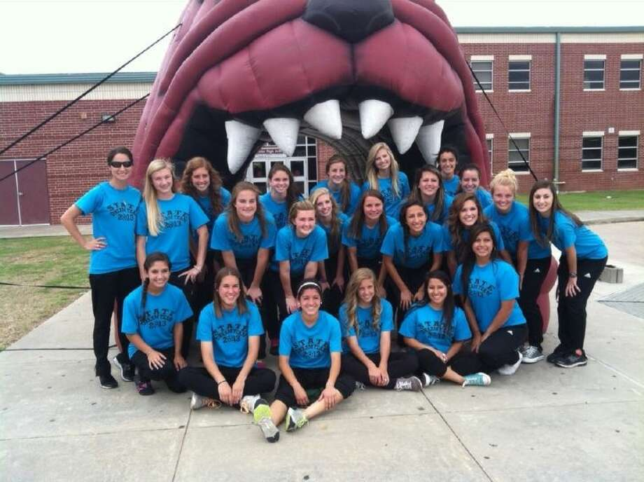 The Magnolia girls soccer team takes a group photo in front of the Bulldog, at the school spirit rally on Wednesday, prior to leaving for the State Championships in Georgetown. Photo: Magnolia ISD