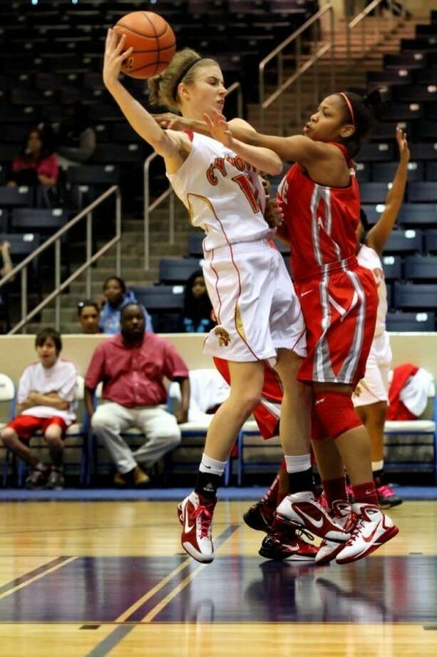 PHOTO BY KJWESPHOTOS.COM: Jenny Nash, left, played four seasons of varsity basketball for Cy Woods before graduating earlier this month. The Nicholls State signee was a volunteer coach for Cy Woods' team in the Alodia Summer League.