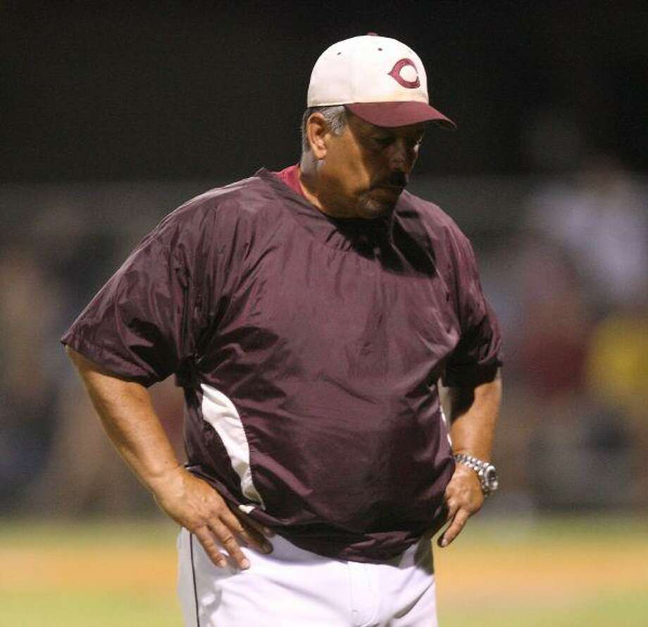 Clear Creek coach Jim Mallory is lost in his thoughts as the final game turns against the Wildcats.
