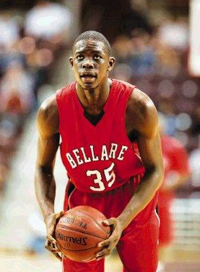 Bellaire senior Tobi Oyedeji, shown her eyeing the rim during a free throw attempt, was named the District 20-5A Most Valuable Player when the recent all-district selections were announced. The 6-foot-9 senior has signed to play basketball at Texas A & M and he averaged 16 points and just over seven rebounds per game this season for the Cardinals. / ©2010 Kevin B Long. All rights reserved.