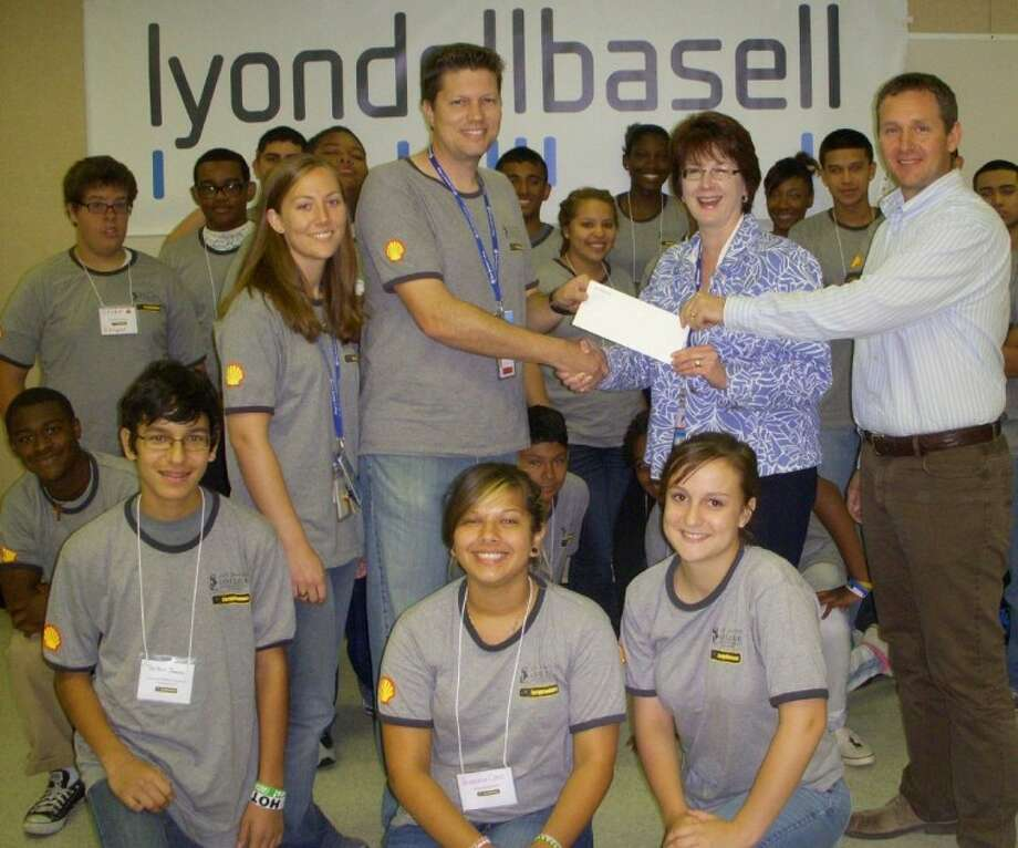 "Mike Middleton and Gayden Cooper of LyondellBasell present a 6,000 grant to instructor Shane May and assistant Cortney Taylor of San Jacinto College's EnergyVenture Camp (from right). Students from EnergyVenture were treated to a behind-the-scenes look at science at work during a tour of the LyondellBasell La Porte Complex June 22. The ""Fostering Success"" education grant funded 10 LyondellBasell Scholars and the EnergyVenture Reunion Program next February. Photo: Courtesy LyondellBasell"