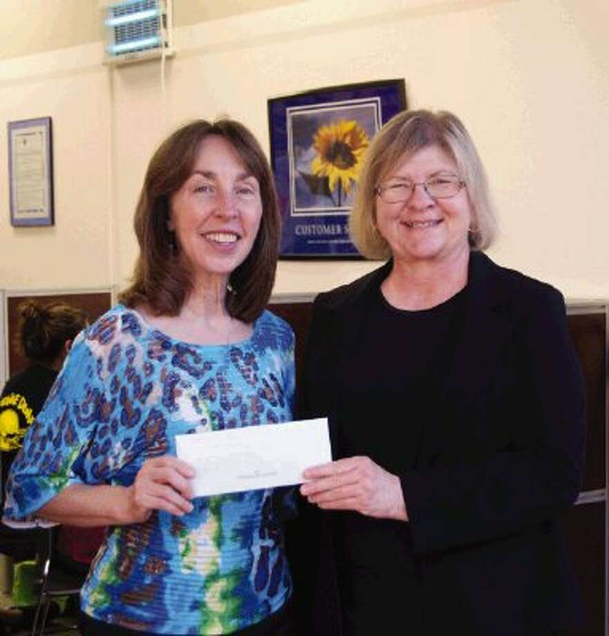 Jenice Coffey, left, presents EOC Director Jane Brody with a donation from the Pilot Club of Baytown.