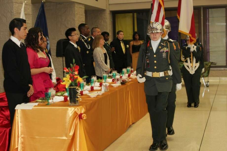 Cadets from Humble High School's JROTC present colors at the program's annual Military Ball April 14.