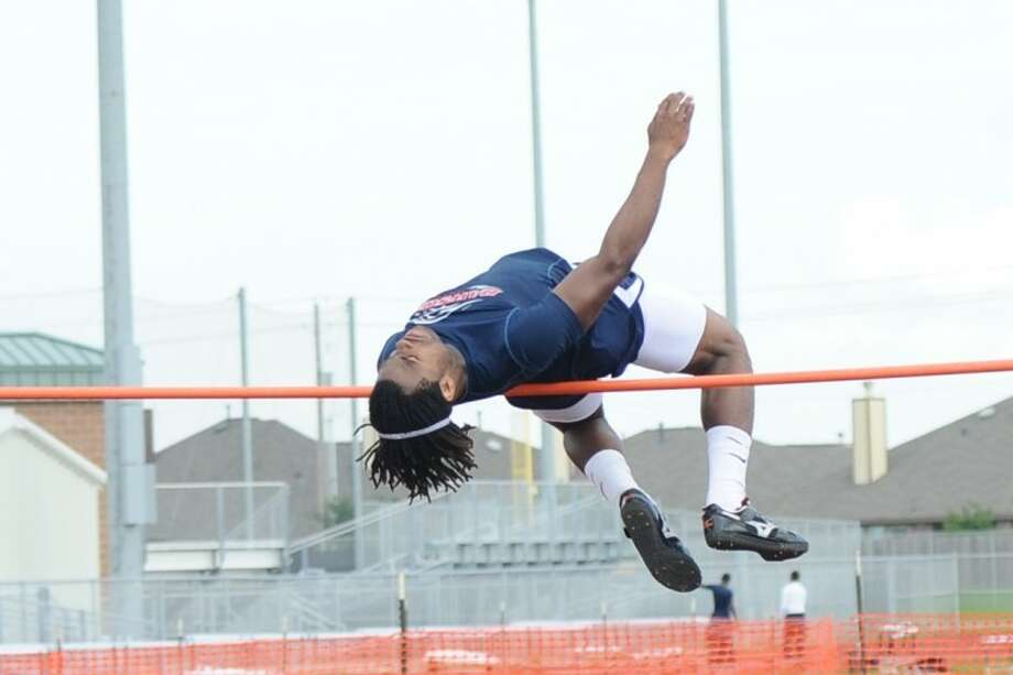 Dawson's David Parker cleared 6 feet, 8 inches to win the high jump Wednesday at the District 24-4A track meet at Clear Falls High School. Photo: KIRK SIDES