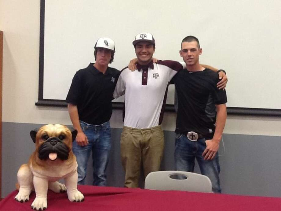 Magnolia Bulldog baseball players Cole Williams, Garret Luna, and Kyle Black pose for a photo after signing their letters of intent to play in college next season. Photo: Shelly Black