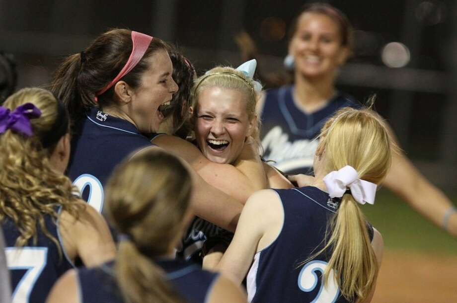 Clements pitcher Nikki Murray is mobbed by her teammates after striking out the last player for Travis to end Tuesday's game. The Lady Rangers clinched the outright district title with a win over Travis.(Photo by Alan Warren) Photo: Photo By Alan Warren