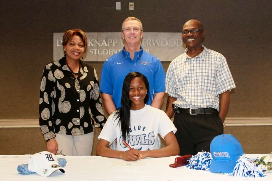Episcopal senior Chioma Nwankwo signed a National Letter of Intent to attend and run track for Rice University, celebrating the achievement with herparents, Kanu and GerryNwankwo, and EHS track and field coach Dick Phillips. Photo: EHS/Mumford 2012
