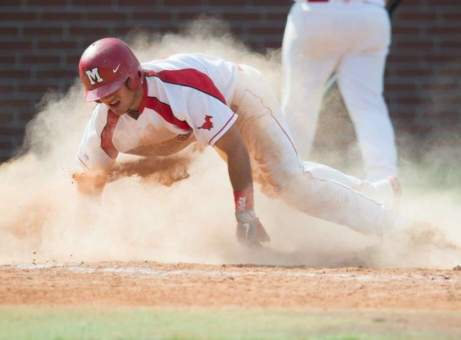 Memorial senior Aaron Ruzinsky slides home with the winning run in the bottom of the ninth Saturday at Mustang Park. Memorial defeated Strake Jesuit 3-2 in a District 19-5A game. Photo: Kevin B Long/GulfCoastShots.com