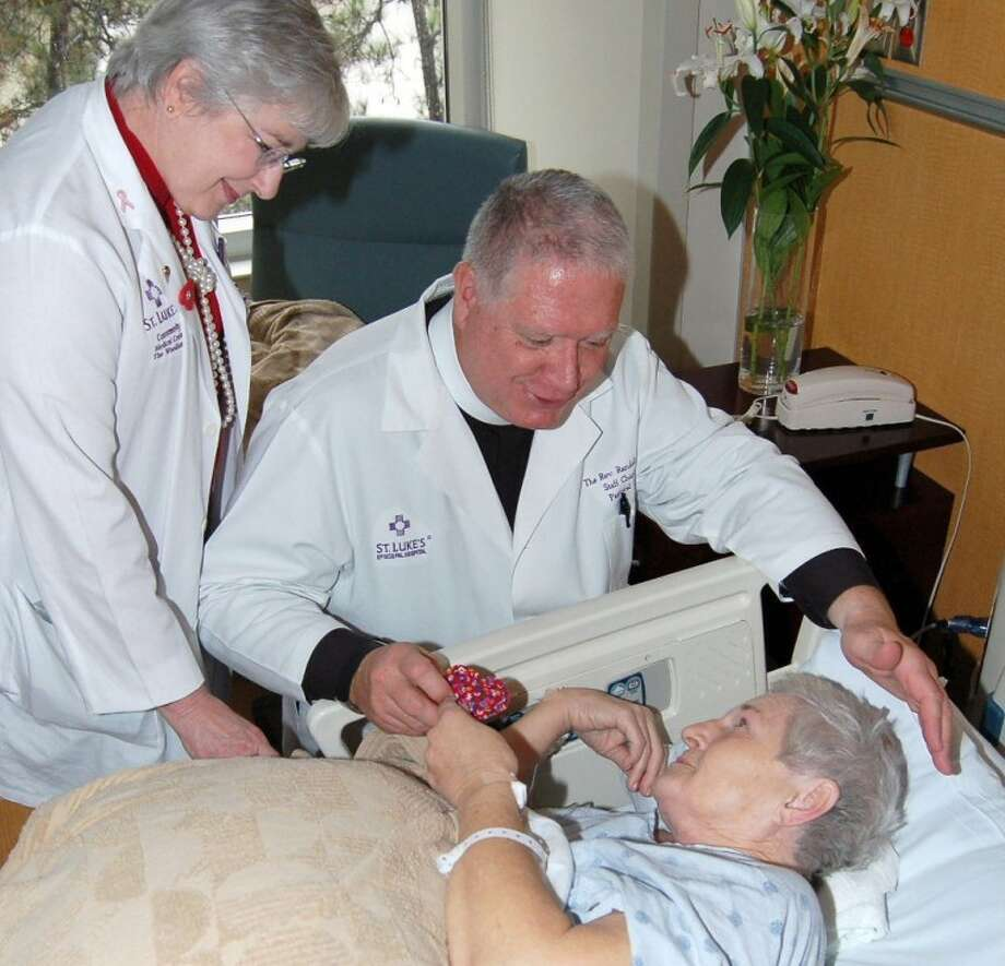 Chaplain Randall Trego and Chaplain Assistant Barbara Carmichael visit with Jo Dillard, a patient at St. Luke's The Woodlands Hospital.