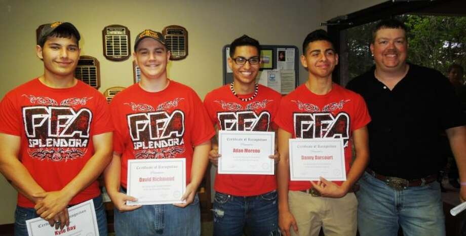 Coach Randy Dobbins, far right, with his agricultural mechanic students were recognized at the Splendora ISD April 15 meeting.
