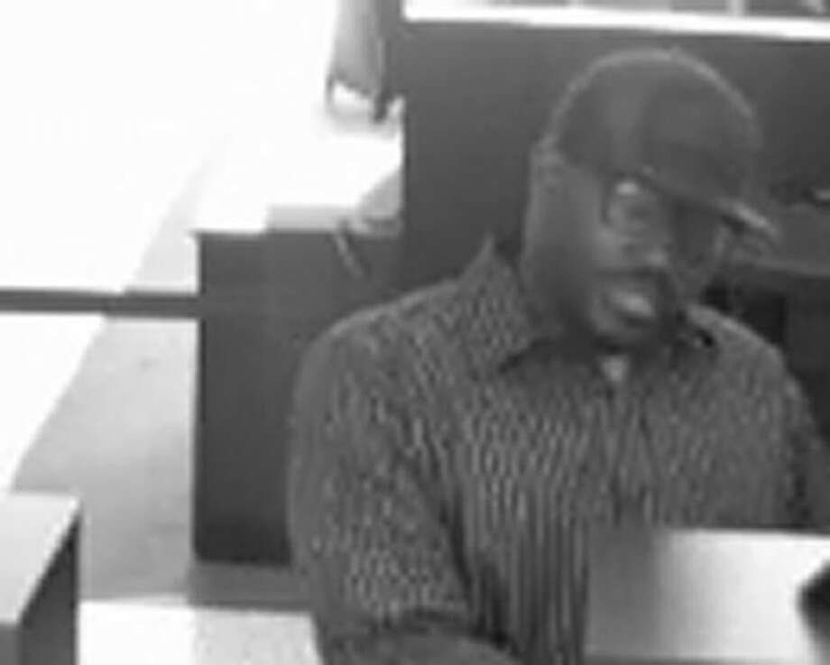 Surveillance cameras caught the 'Backpack Bandit' on film during a bank robbery in Atascocita in March. Now officials believe the same suspect struck at a Kingwood bank earlier this week.