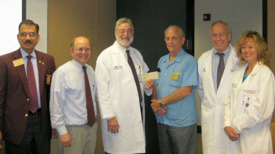 Oyster Creek Rotary presents Baylor College of Medicine with a $1,000 donation for epilepsy research. Pictured left to right, Sunny Sharma, 2010-11 rotary district governor; Dr. Edward Cooper and Dr. Eli Mizrahi of BCM; Mike Baker, 2010-11 president, Oyster Creek Rotary; and Dr. Jeff Noebels and Dr. Alica Goldman of BCM. Photo: Submitted Photo