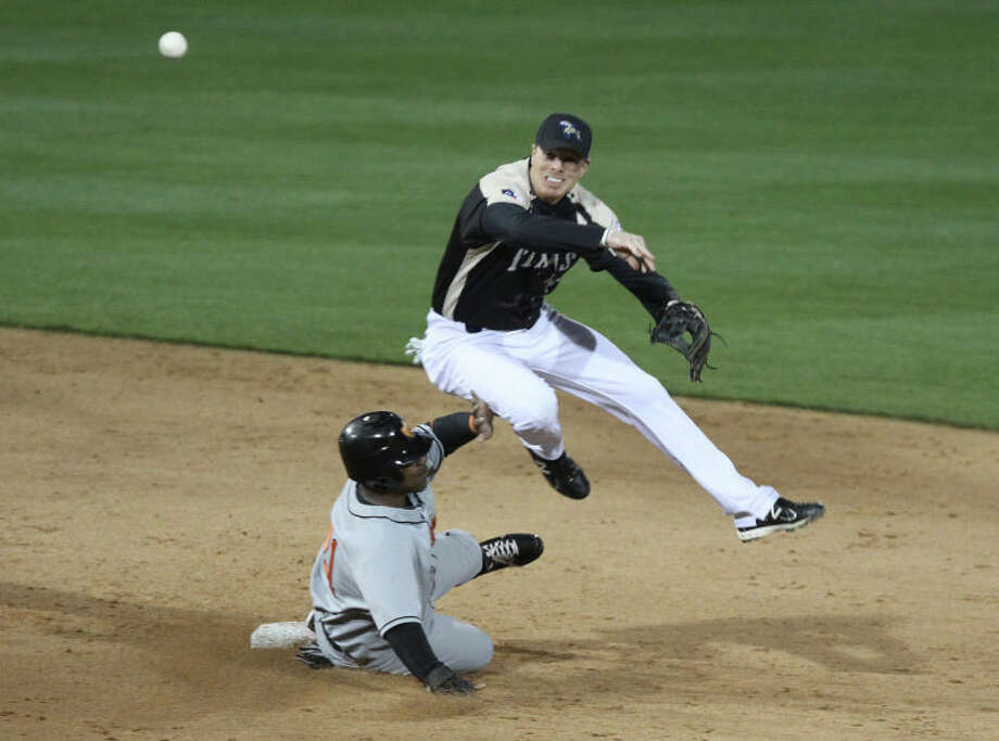 Cy Falls graduate and Skeeters second baseman Chase Lambin tries to turn a double play during Sugar Land's 3-0 victory April 18 against Long Island at the Sugar Land Skeeters Opening Day at Constellation Field in Sugar Land.Visit www.hcnpics.com for more photos. Photo: Alan Warren/HCN