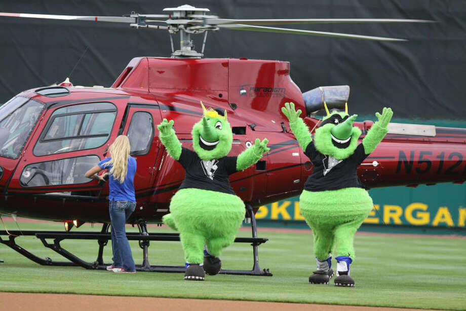 Swatson and Mo arrive by helicopter at the Sugar Land Skeeters Opening Day at Constellation Field in Sugar Land. The Skeeters host their first playoff games Sept. 17-18 to open the Freedom Division Championship Series. Playoff tickets are on sale July 29. Photo: Alan Warren/HCN