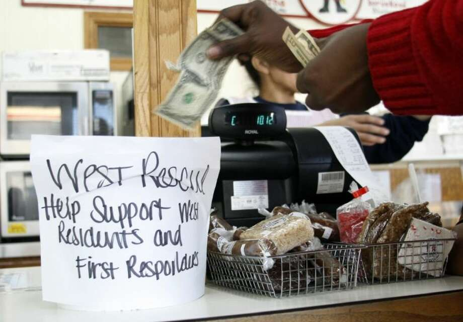 A bucket for placing money for support of residents and first responders is seen here at the Little Czech Bakery in West, Texas, Friday April 19, 2013. The bodies of 12 people have been recovered after an enormous Texas fertilizer plant explosion that demolished surrounding neighborhoods for blocks and left about 200 other people injured, authorities said Friday. (AP Photo/Mike Fuentes) Photo: Mike Fuentes