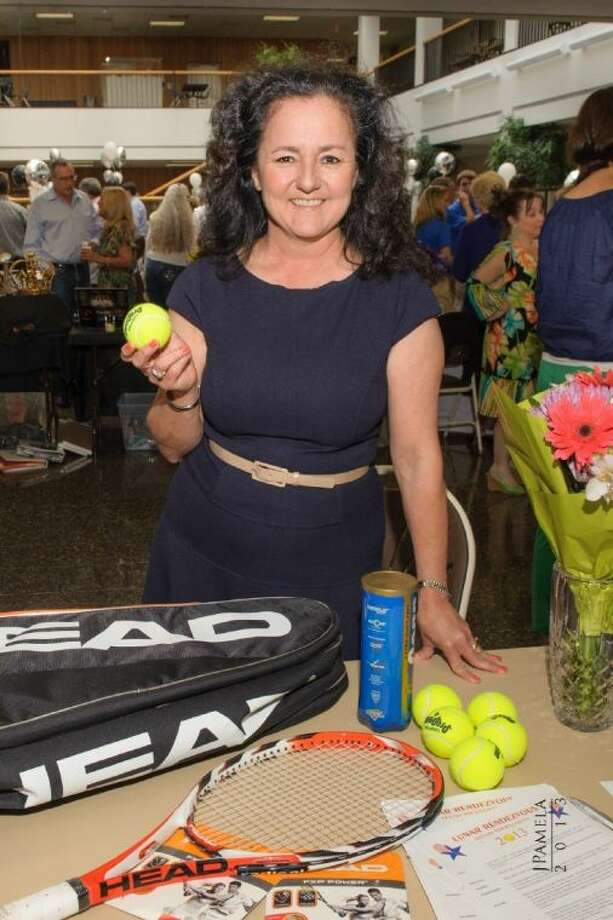 Ruth Rendon, Lunar Rendezvous Festival tennis tournament co-chairman, prepares for the upcoming tournament which will be held April 26-28 at the South Shore Harbour fitness center. Photo: SUBMITTED PHOTO