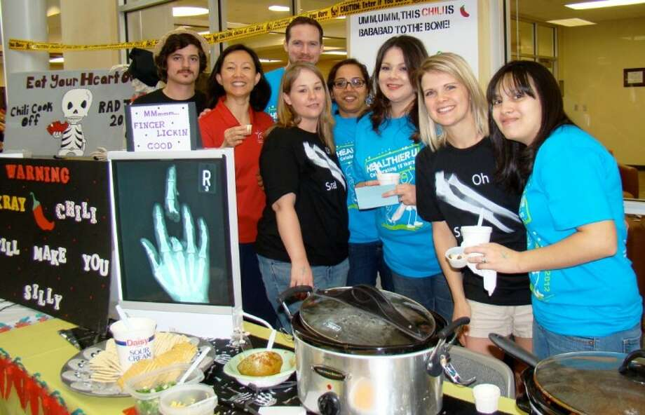 """A group of Lone Star College-Montgomery's radiologic technology students showcases their """"X-Ray Chili,"""" one of the many crock-pot creations available to taste - and judge - at the college's annual Healthier U Heart-Healthy Cook-Off and Bake-Off held in early April."""