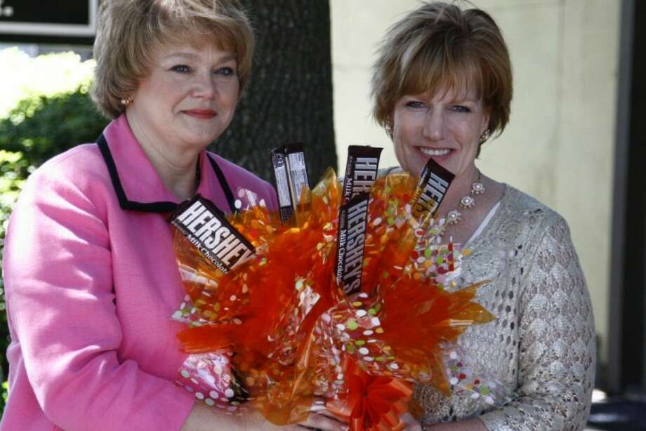 Ellen Holt, left, and Molly Kleinguetl show off an example of a creative candy bouquet they can make for any celebration, party or event with their new business, Debonair Affairs.