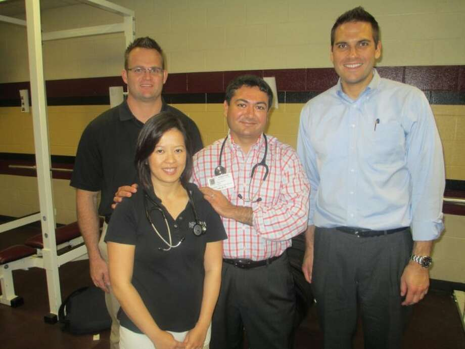 Assisting in providing physicals to students last year were, from left, Shaun Weaver, M.D., Doan Do, M.D., Tejas Mehta, M.D. and Wasyl Fedoriw, M.D.