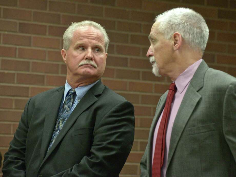 Former Brookfield school finance director Art Colley, left, with attorney Eugene Riccio, was sentenced Wednesday to three years probation for stealing thousands of dollars from the district. September 28, 2016, in state Superior Court, Danbury, Conn. Photo: H John Voorhees III, Hearst Connecticut Media / The News-Times