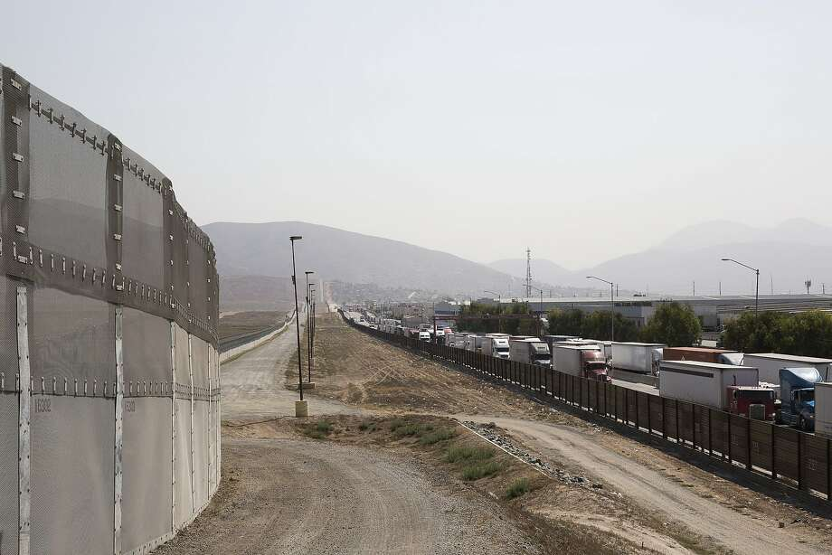 A long line of trucks coming from Tijuana, Mexico, enter the U.S., on the south end of San Diego, Few countries would be as vulnerable to a Donald Trump presidency as Mexico, but its minister of the economy says his country must not overreact to campaign rhetoric. Photo: EROS HOAGLAND, NYT