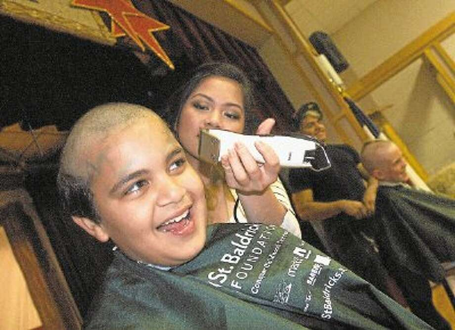 Omir Mohammed enjoys being one of the first Bunker Hill Elementary students to have his head shaved as part of his contribution to the St. Baldrick's Foundation. Photo: Rusty Graham / @WireImgId=2622998