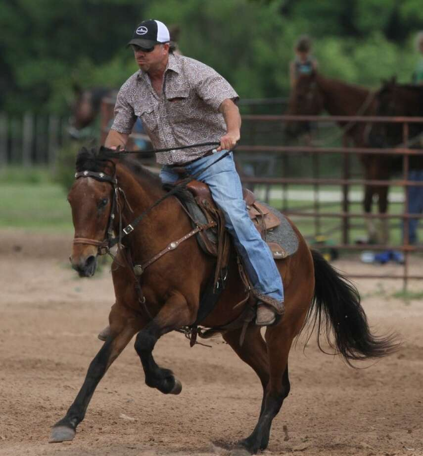 Thomas Boyd, of Conroe, rides 25-year-old Scooby Doo at the Tarkington Prairie Playday Series on Saturday. Even though Scooby is blind, he and Boyd are tied for first place in the competition. The finals are set to take place May 20 at the Half Head Arena on FM 163 in Tarkington Prairie.