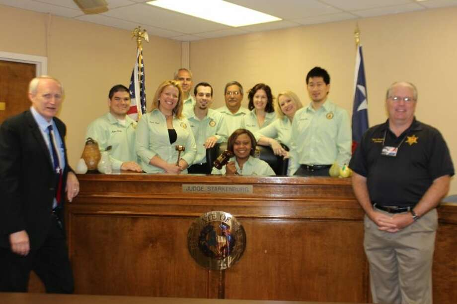 Pictured, left to right, front row: Judge Gordon Starkenburg, Justice of the Peace and Buck Stevens, Brazoria County Constable Sitting in Judges Seat: Sparkle Anderson, City of Pearland. Photo: SUBMITTED PHOTO