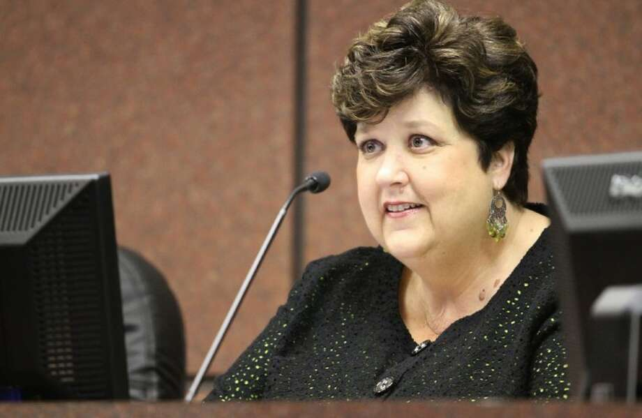Vickie Morgan, once an elementary school room mom, listens to comments of a speaker at Tuesday night's Board of Trustees meeting. Morgan this month began her 26th year of service as a board member, the longest tenure in Pasadena ISD history. Photo: Courtesy Pasadena ISD