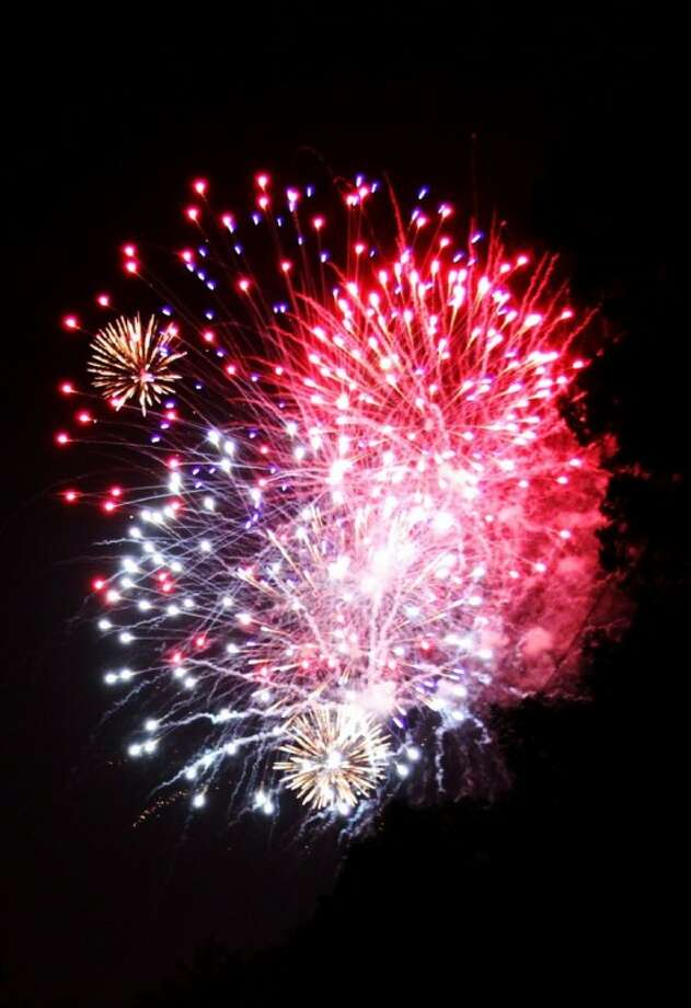 The annual Roman Forest Independence Day celebration in 2010 included this fireworks show (above). However, event organizers canceled the show because of the countywide ban imposed on the sale of consumer fireworks starting June 24. While there won't be any fireworks show, the city's Fourth of July parade will continue starting at 10 a.m. Last year's parade attracted a variety of motorized groups, such as this group of flag-waving motorcycle drivers. Line up begins at 9 a.m.in front of the Roman Forest City Hall.