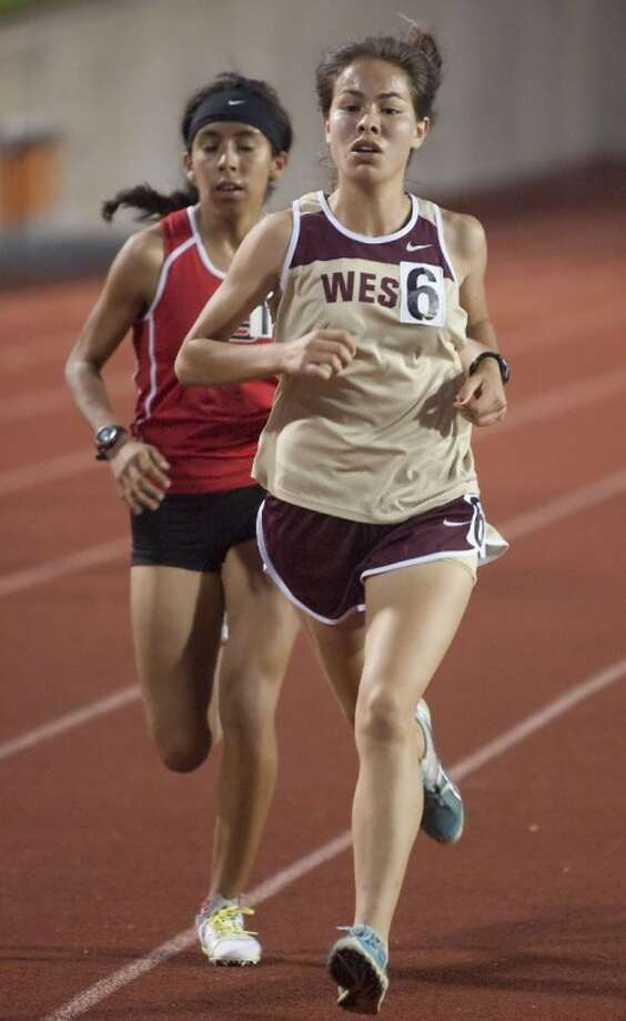Magnolia West's Ana Moreno competes in the 3,200-Meter Run during the Region III-4A Track and Field Championships Friday at Bowers Stadium in Huntsville. Moreno qualified for the 4A state meet in the two-mile run, coming in second overall with a 11:25.81 for a silver medal. See more photos online at yourhoustonnews.mycapture.com. Photo: Karl Anderson