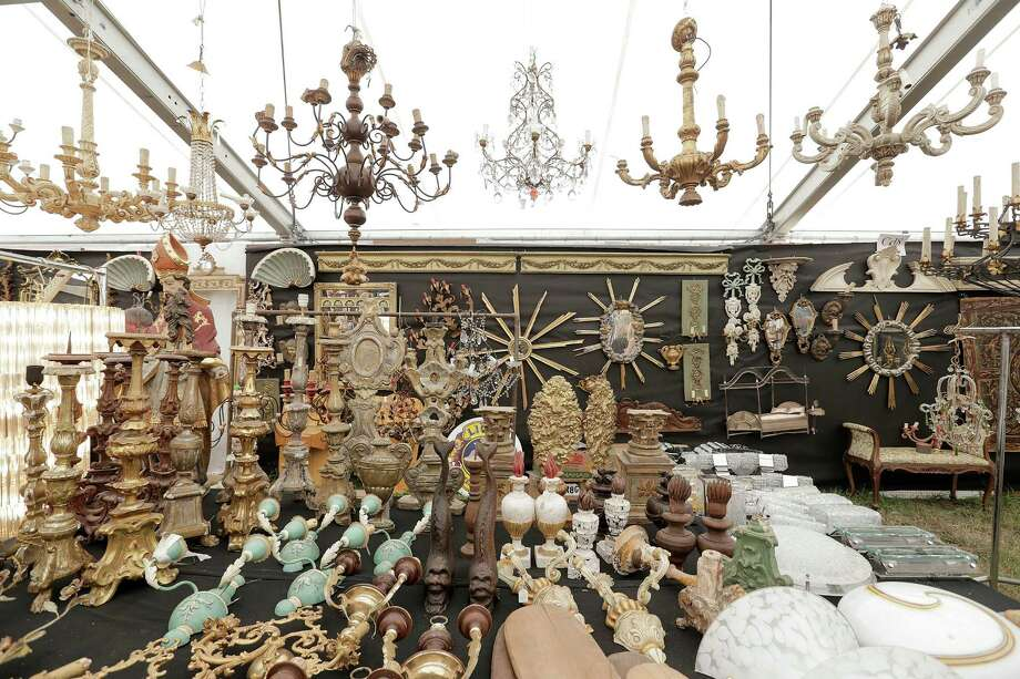 From candle stick holders, pendents, sconce and chandeliers, one can find a variety of lighting at the Round Top Antique Show. Photo: Elizabeth Conley, Houston Chronicle / © 2016 Houston Chronicle