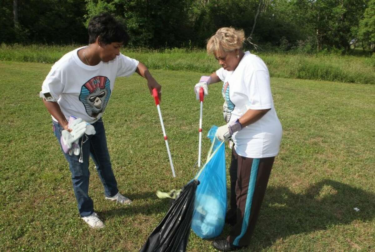 (L to R)Tracy Davis and Vanessa Miller, both of Missouri City, pick up trash during the Great American Cleanup 2012 at Buffalo Run Park in Missouri City.