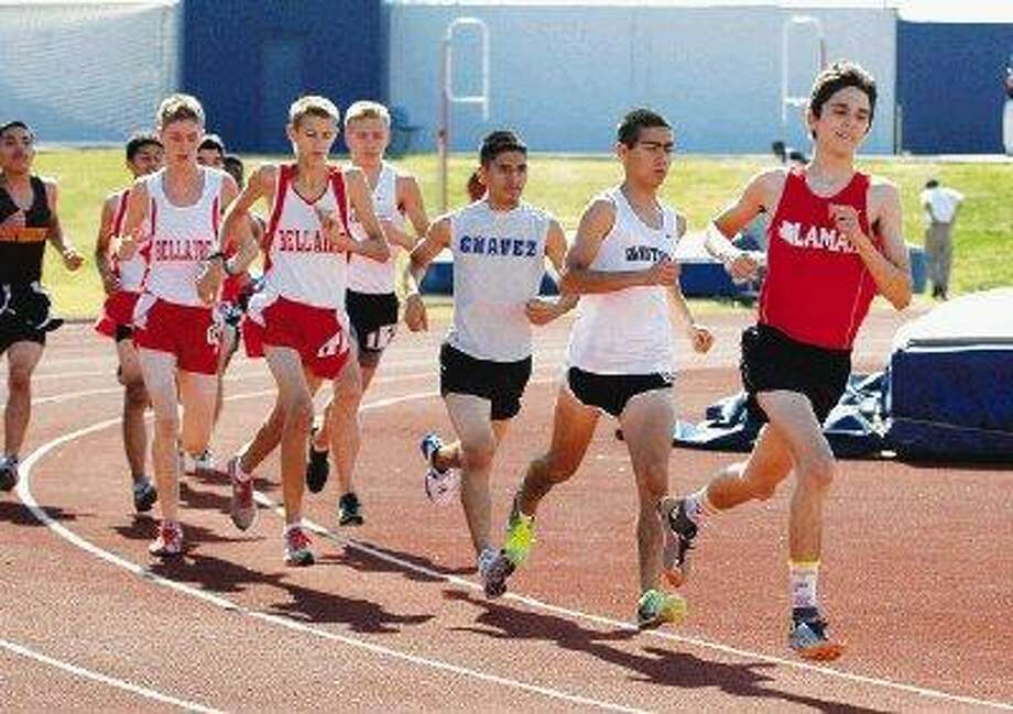 Bellaire runners Erik Hawkins (left) and Philip Davis are just off the pace in the 3,200-meter run at the District 20-5A track and field meet.