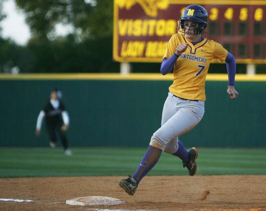 Montgomery's Carly Holder triples in the fourth inning Friday night against Magnolia. To view or purchase this photo and others like it, visit HCNpics.com.