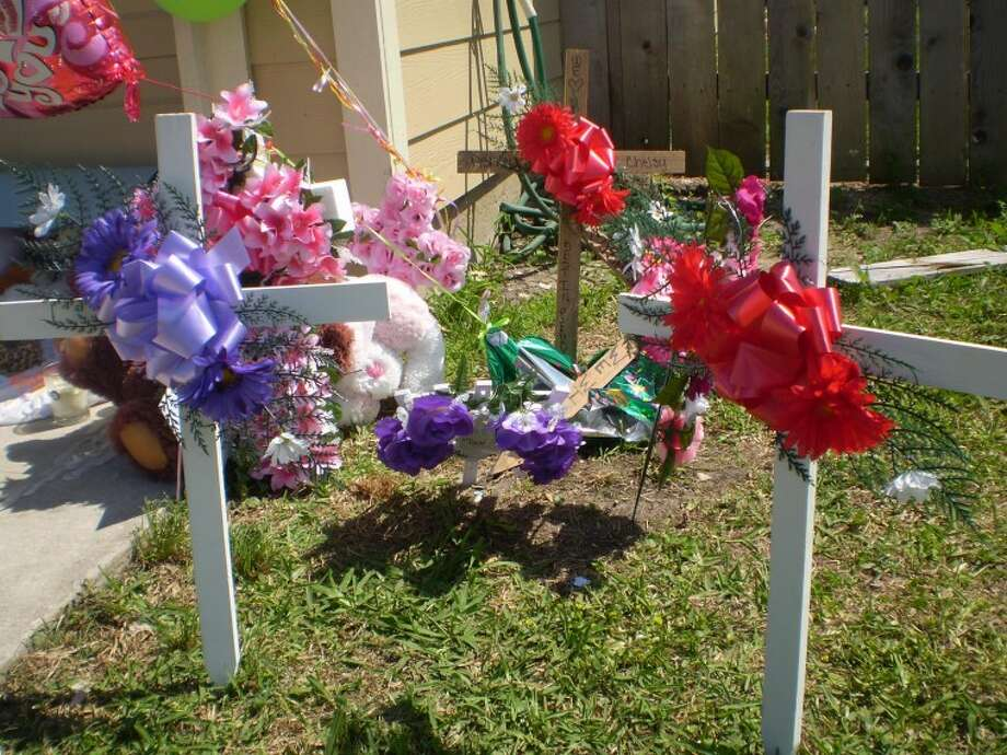 Since the Sunday morning fire that revealed two deseased teenagers, hundreds of supporters have trekked to the Baytown home on Lloyd Lane to say a prayer and contribute to this makeshift memorial, which strecthes across the entire front of the home.
