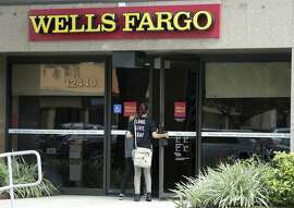 In this Thursday, Sept. 22, 2016, photo, customers walk into a Wells Fargo bank in Pembroke Pines, Fla. Experts say Wells Fargo customers concerned about whether their accounts have been tinkered with shouldn�t wait for word from the bank. They say customers need to review all accounts, scour their credit reports, think carefully before closing a credit card account and perhaps even consider leaving the bank. That comes after Wells Fargo has been fined $185 million by regulators who said bank employees opened more than 2 million unauthorized deposit and credit card accounts to meet sales goals. (AP Photo/Lynne Sladky)