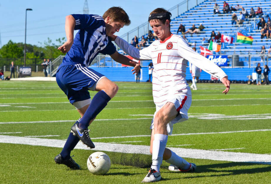 Connor Hartung (7) and Nick Price (11) battle for possession of a loose ball near the touchline during the second half of a UIL boys soccer state semifinal between Kingwood and Coppell on April 19, 2013, at Birkelbach Field in Georgetown, Tex. Photo: Photo By Stephen Whitfield