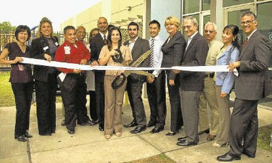 The Spring Branch Community Health Center formally opened its dental clinic last month in its facility in the Spring Branch Family Development Center on Pitner. CEO Marlen Trujillo cuts the ribbon, joined by (from left) Frances Chau and Jessica Smith of the Houston West Chamber of Commerce; Andres Garcia of H-E-B- Bunker Hill; Ernest Arredondo, SBCHC board; Gladys Tello, SBCHC nurse practitioner; Mike Smith, SBCHC chief develoopment officer; Trujillo; Michael Bsaibes, SBCHC chief operations officer; Dr. Richard Le, dental director; Houston council member Brenda Stardig; SBCHC board chair Dr. Louis Faillace; Peter Carrico, HWCoC; Pauline Dunglinson, SBCHC chief financial officer; and Ricardo Barnes, executive director, Spring Branch Family Development Center. The Pitner clinic offers affordable urgent care, preventatvie and secondary preventative dental services to its client population. Photo: Rusty Graham / @WireImgId=2356298