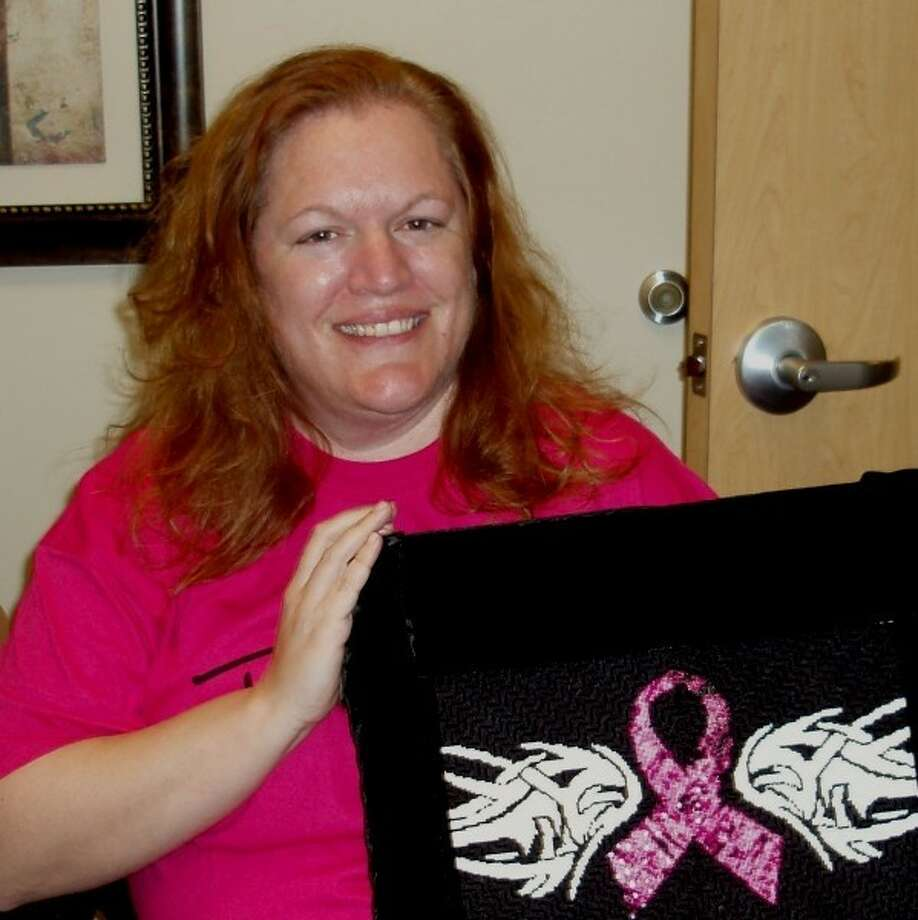 Terri King of Braes Heights will provide needlework instruction to clients waiting for their appointments during Pink Days at The Rose Galleria on July 5. Sponsored by Pink Ribbons, in motion against breast cancer, the first Tuesday of each month (through November) is devoted to helping clients relax and enjoy the arts. The Rose, a nonprofit breast cancer organization, offers a full range of services to the insured and uninsured. King is shown here with a recently completed wall hanging she designed to honor Bikers Against Breast Cancer. Photo: Submitted