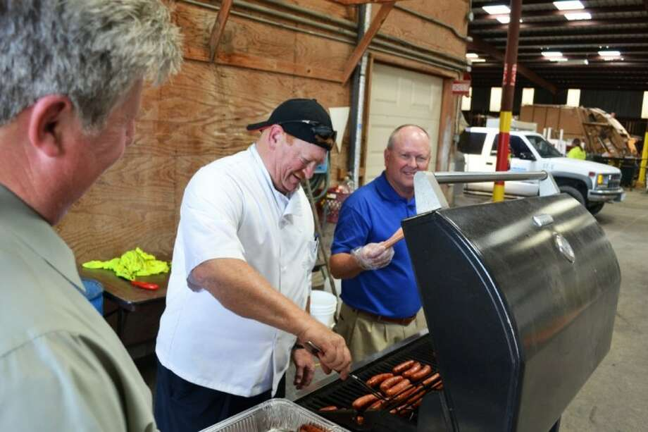 Richmond Chief of Police Bill Whitworth and Fire Chief Mike Youngblood preparing lunch for the City employees. Photo: Submitted Photo